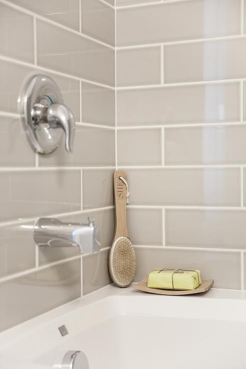 Gorgeous Shower Features A Gray Subway Tile Surround Accented With