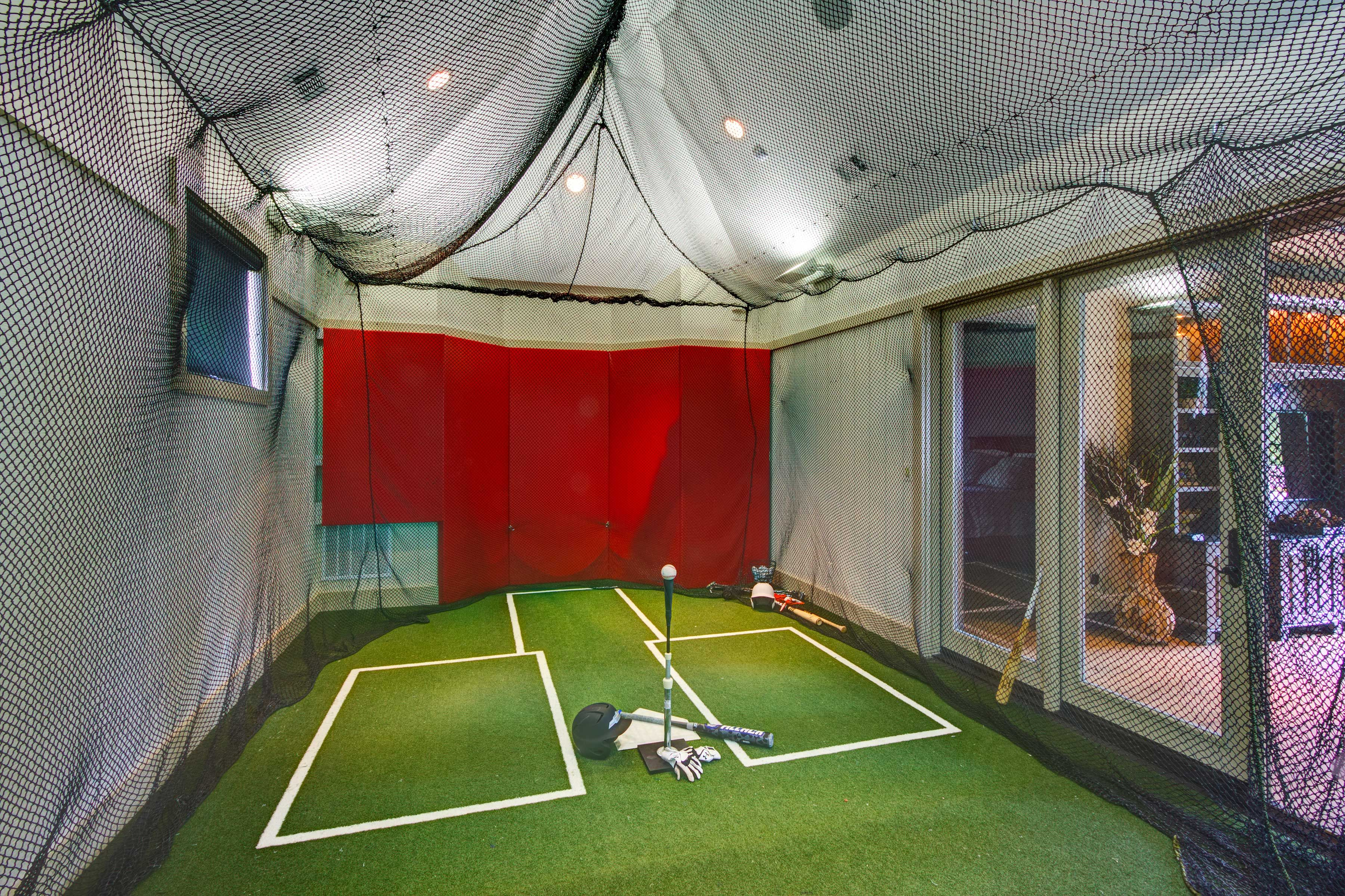 Built For Both Golf And Baseball This Batting Cage Was