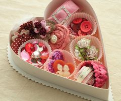 chocolate box filled with craft supplies, jewelry, makeup, candies, cookies...???
