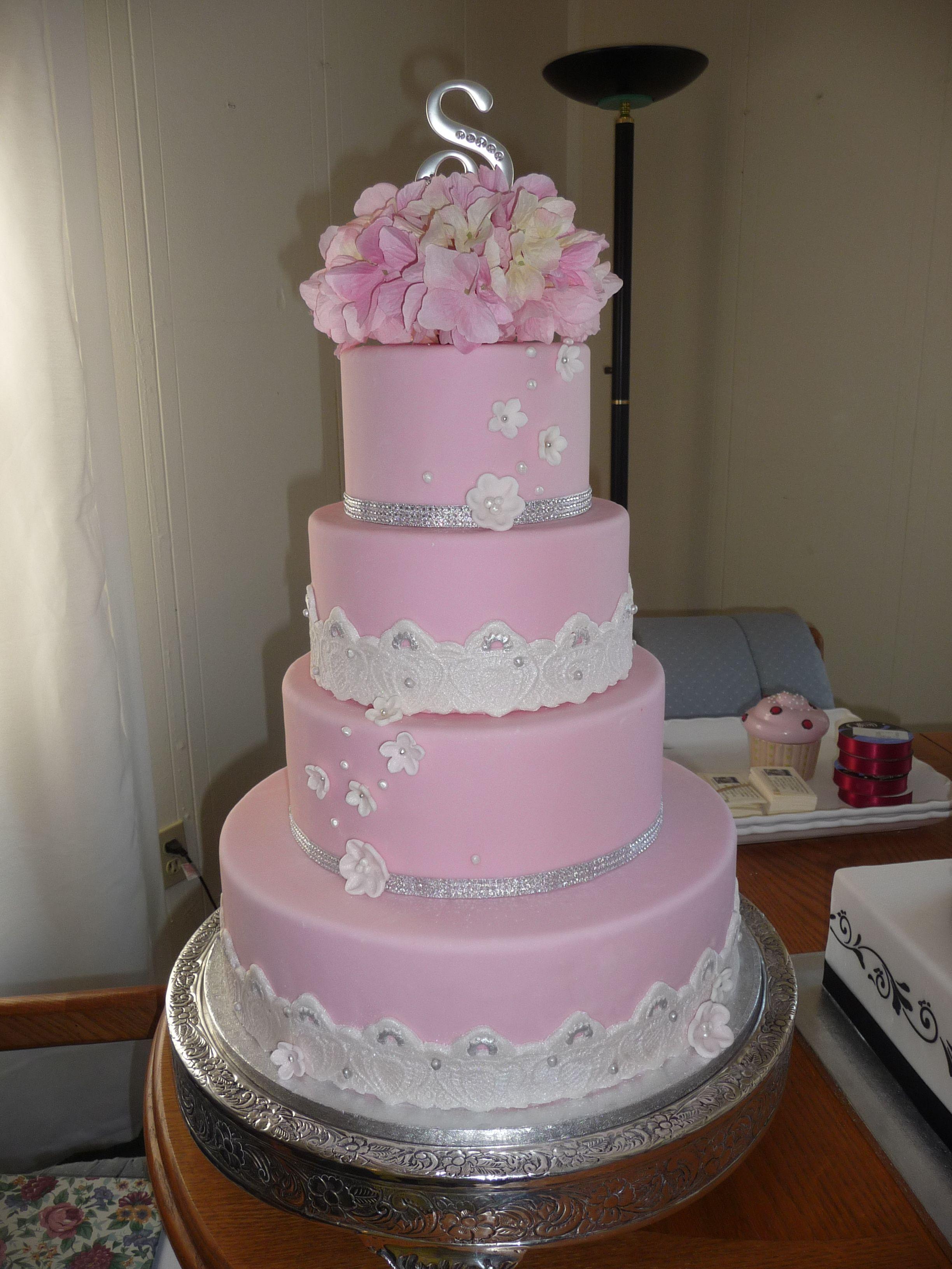 Towering flowers tierd pink u silver wedding cake covered in