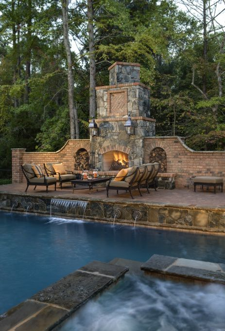 southern outdoor living pool cabana with bathroom and outdoor kitchen and fireplace