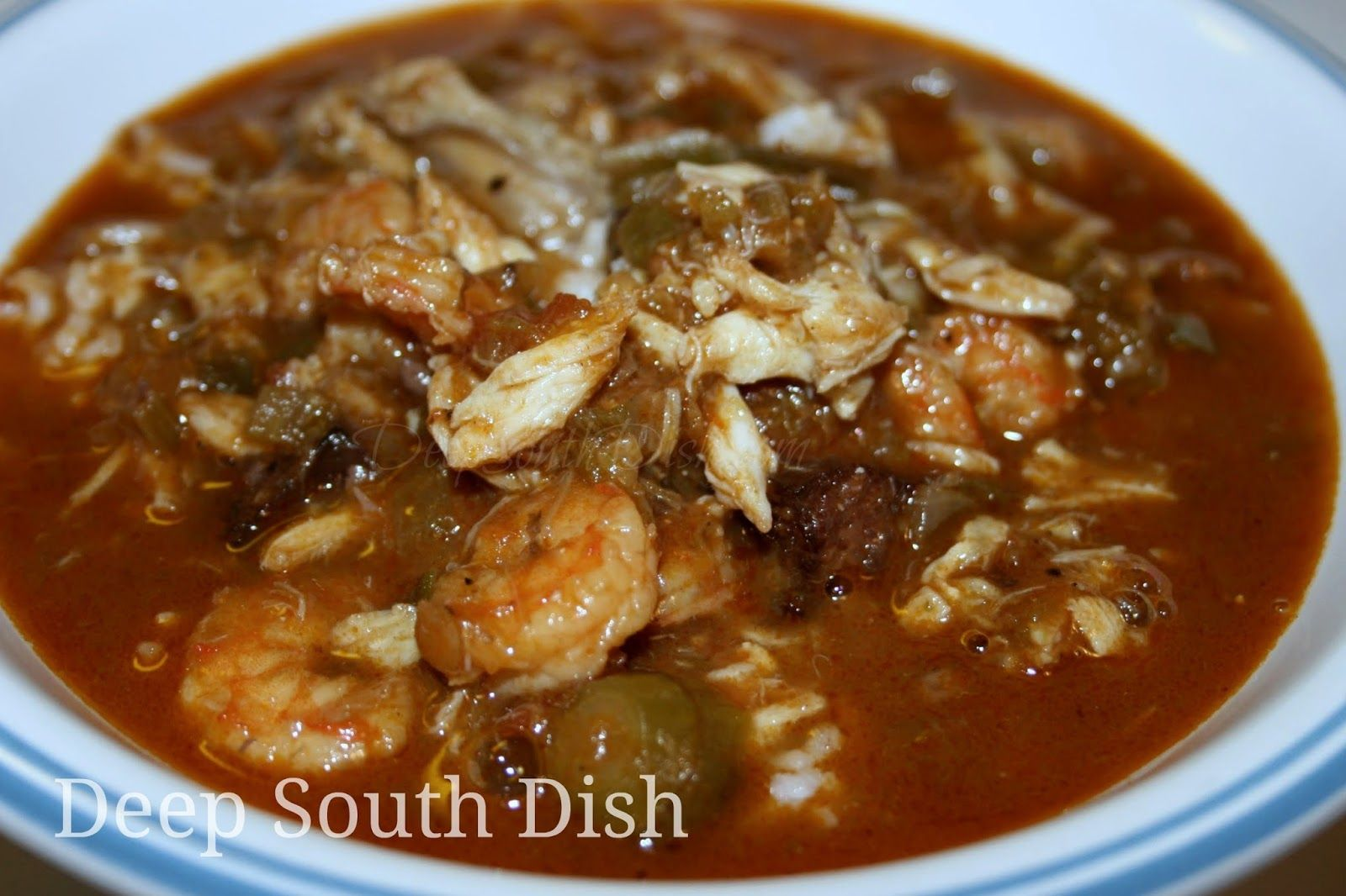 A Seafood Gumbo Made With A Dark Roux A Rich Shrimp Stock The Trinity Of Vegetables Tomatoes Andouille And Shrimp Crab And Oys Creole Recipes Seafood Gumbo Okra Gumbo