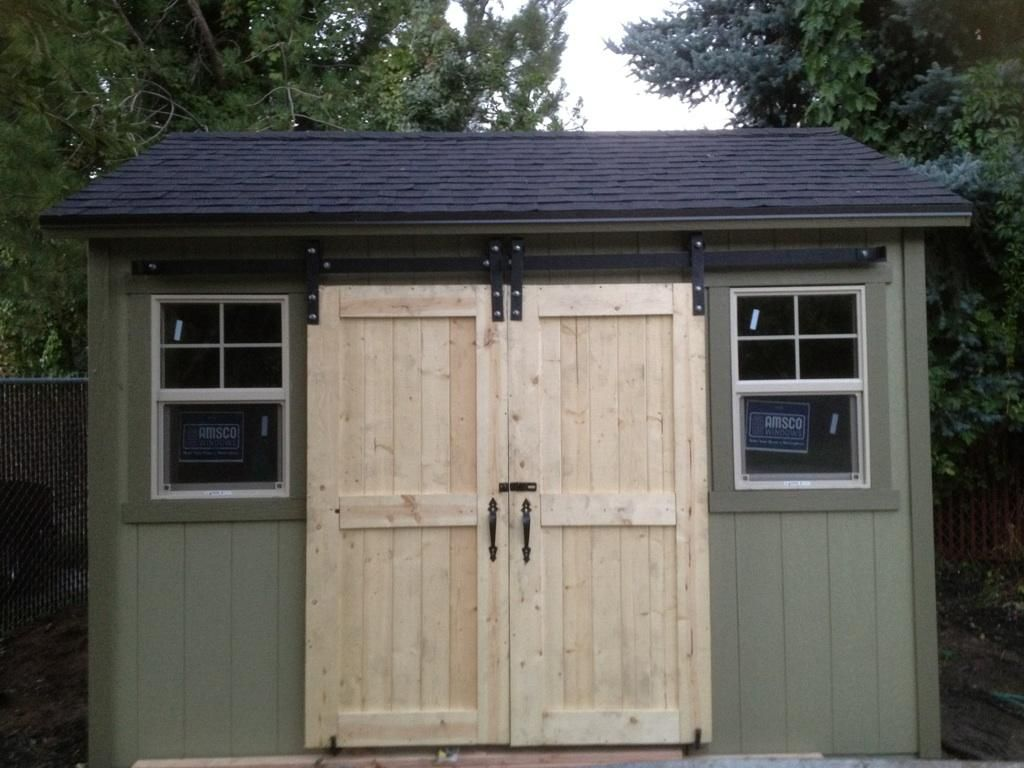 Shed with sliding doors double door v groove sliding for Shed with garage door