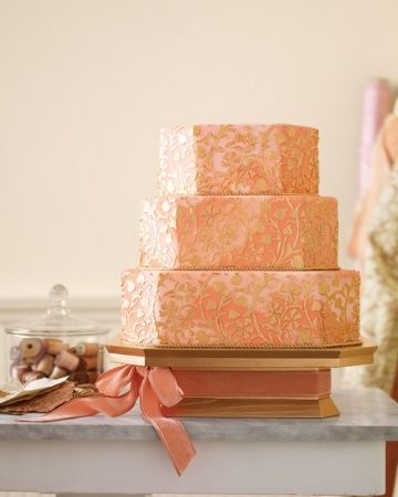 Gilded Wedding Cake- To translate it into sugar and flour, we blended two shades of fondant -- a pale pink and a rosy peach -- to mimic the marbled appearance that hand-dyed cotton takes on in the light. We then spread royal icing over stencils of the pattern's sinuous floral design and painted it with edible luster dust mixed with lemon extrac