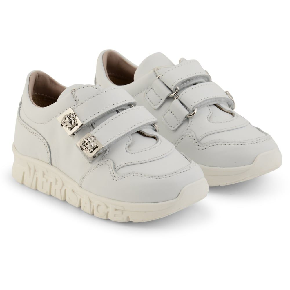 133e5c39dbd4 Young Versace Baby Boys White Trainers with Velcro Straps and Silver Logo  Detailing