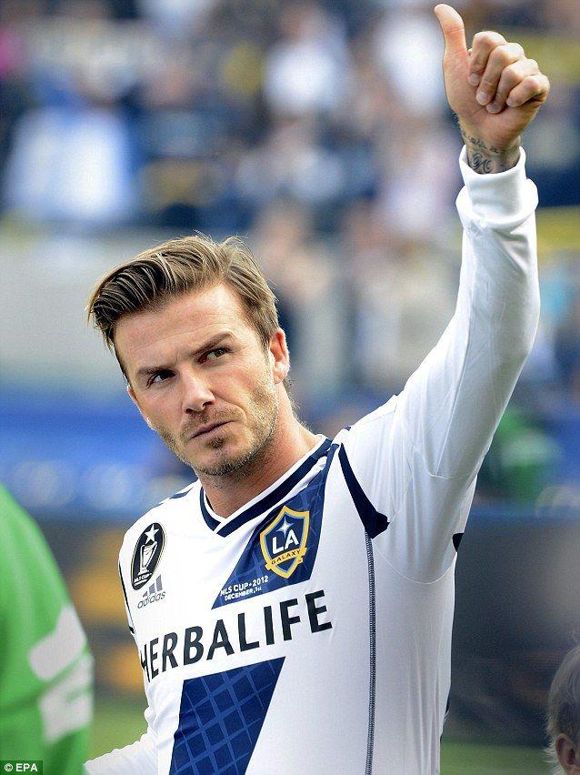 Kissing the next face of football? David Beckham plants a