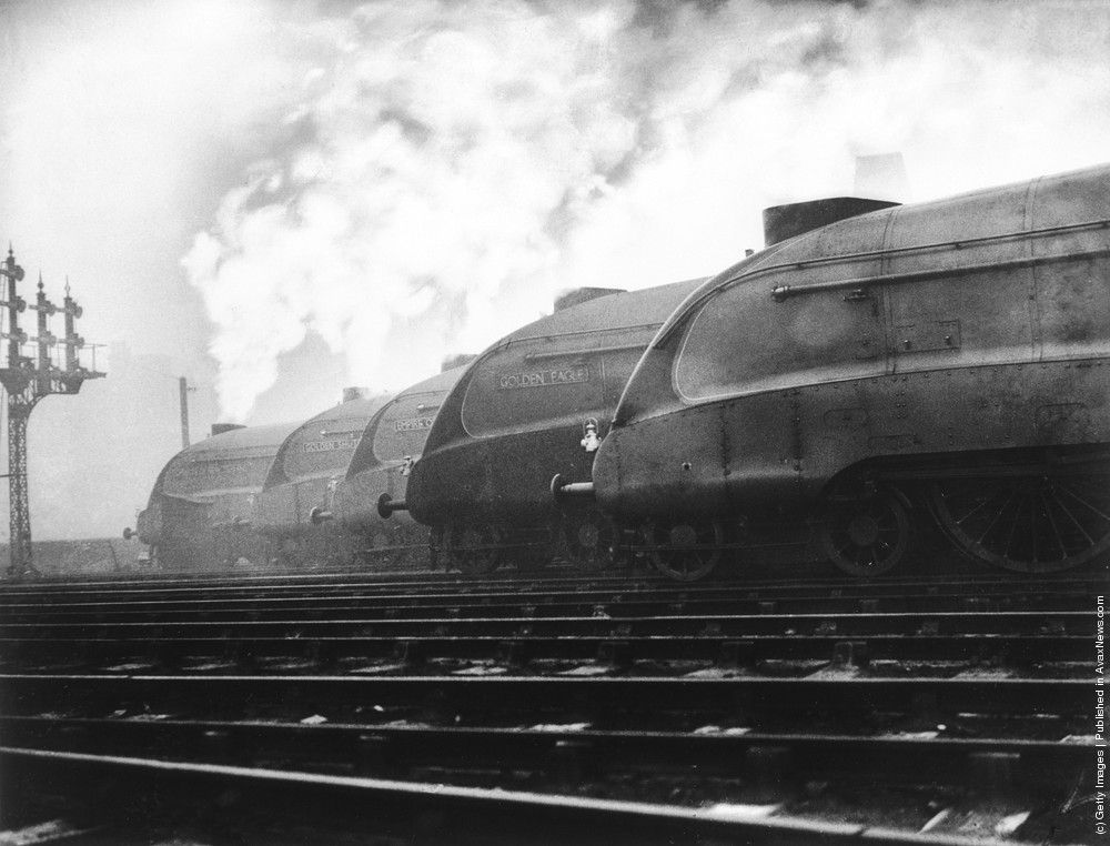Photos anciennes transport par rail a row of lner streamlined locomotives belch out smoke at a london railway station where they are to be tested out
