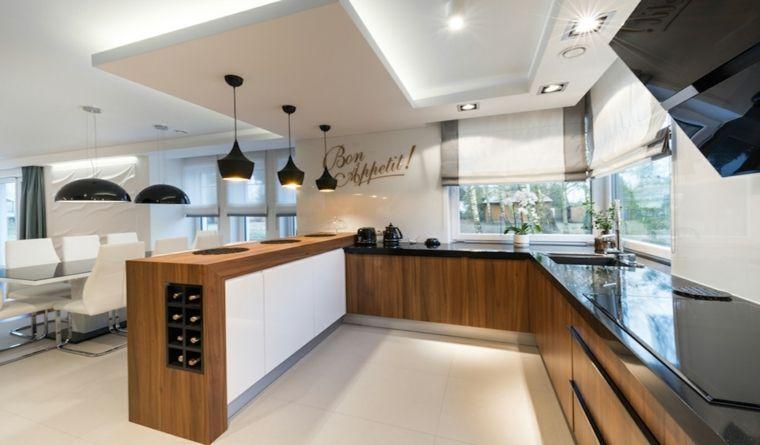 contemporaneo open space arredato con cucina a u in legno con ...