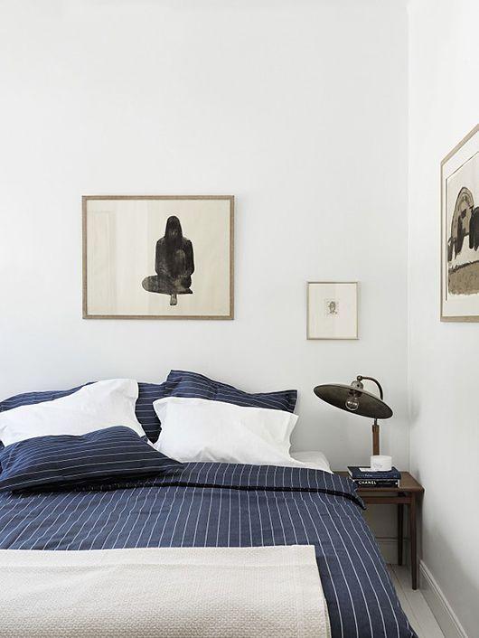 Beautiful Blue Sheets In A Trendy Scandinavian Bedroom