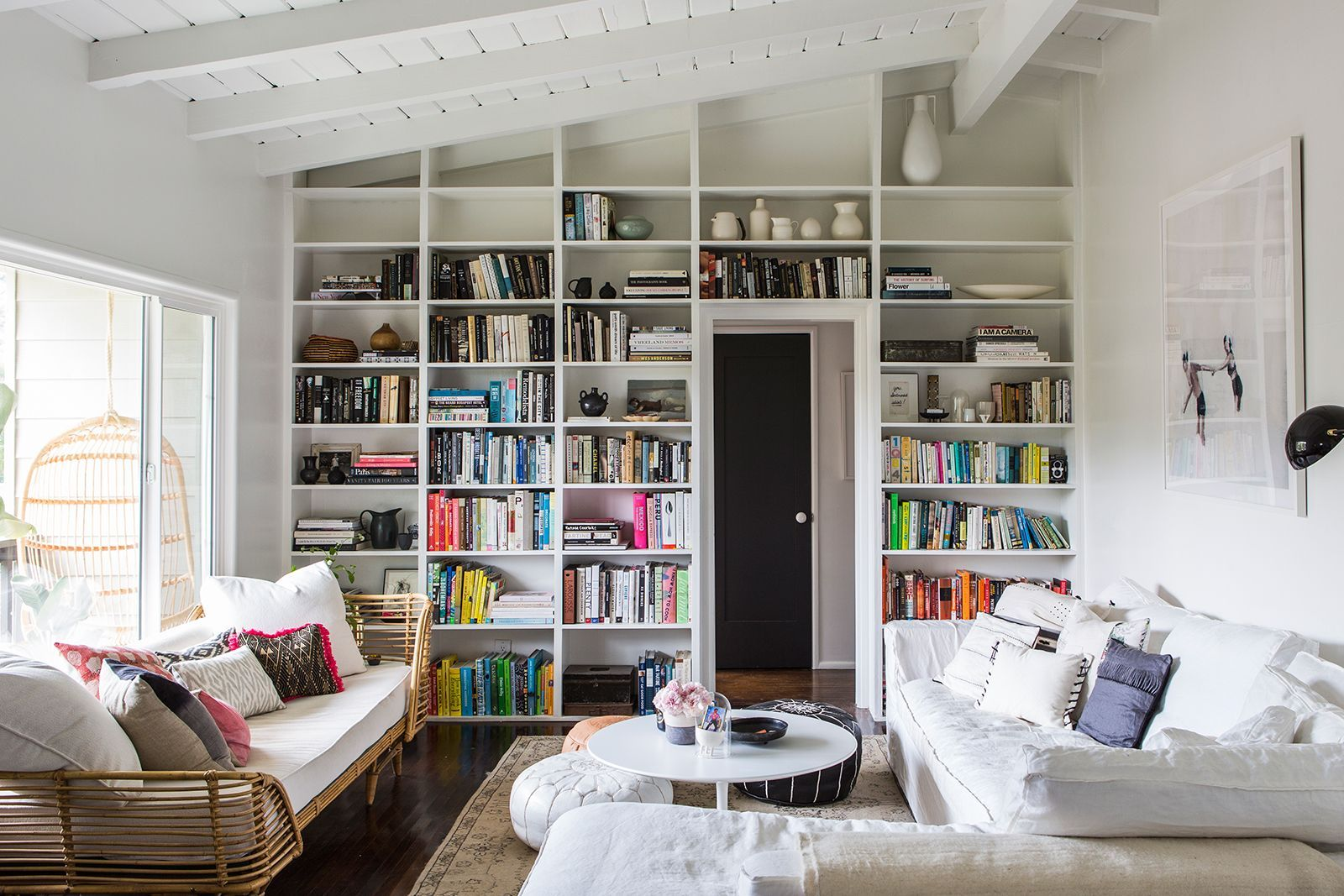 """This Blogger's Brand-New L.A. Home Is Impossibly Dreamy #refinery29  http://www.refinery29.com/2015/09/94026/sf-girl-by-bay-blog-home-tour#slide-1  In an ingenius move, Smith decided to fashion a completely custom built-in bookcase for this previously empty wall. """"The room looked kind of boring without it,"""" she told us. """"My carpenter, Colin Hughes, and I talked about what kind of design it would be and how it would go flush with the ceiling. He built it up to tha..."""