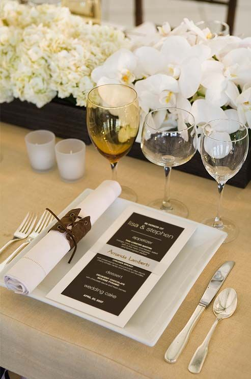 Alternate white Phalaenopsis orchids with clusters of hydrangeas or other white flowers to add texture to a centerpiece.
