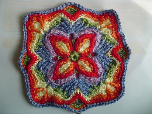 overlay crochet- the trick is to mostly work into the back loop only, so that when you go to make the stitches over the the front of the piece, you can work them into the exposed front loops, (you sometimes do front post stitches), makes a very cushy fabric