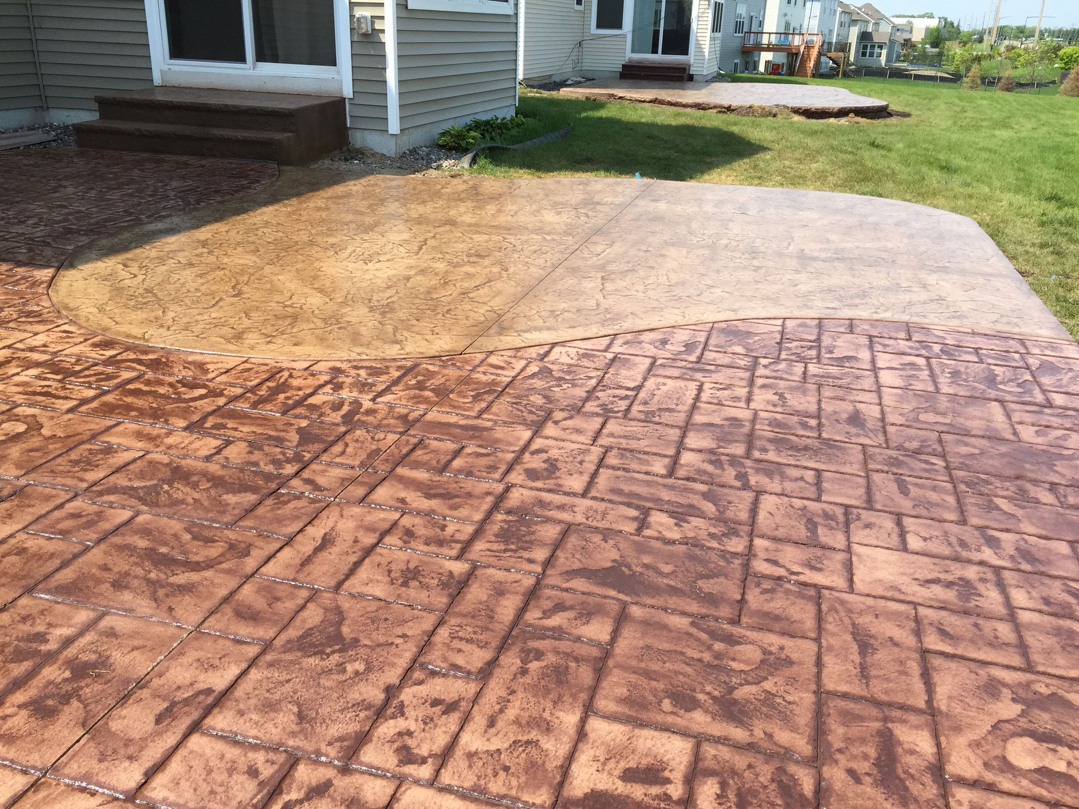 Blue Stone Ashler With Roman Slate Stamped Concrete Patio By