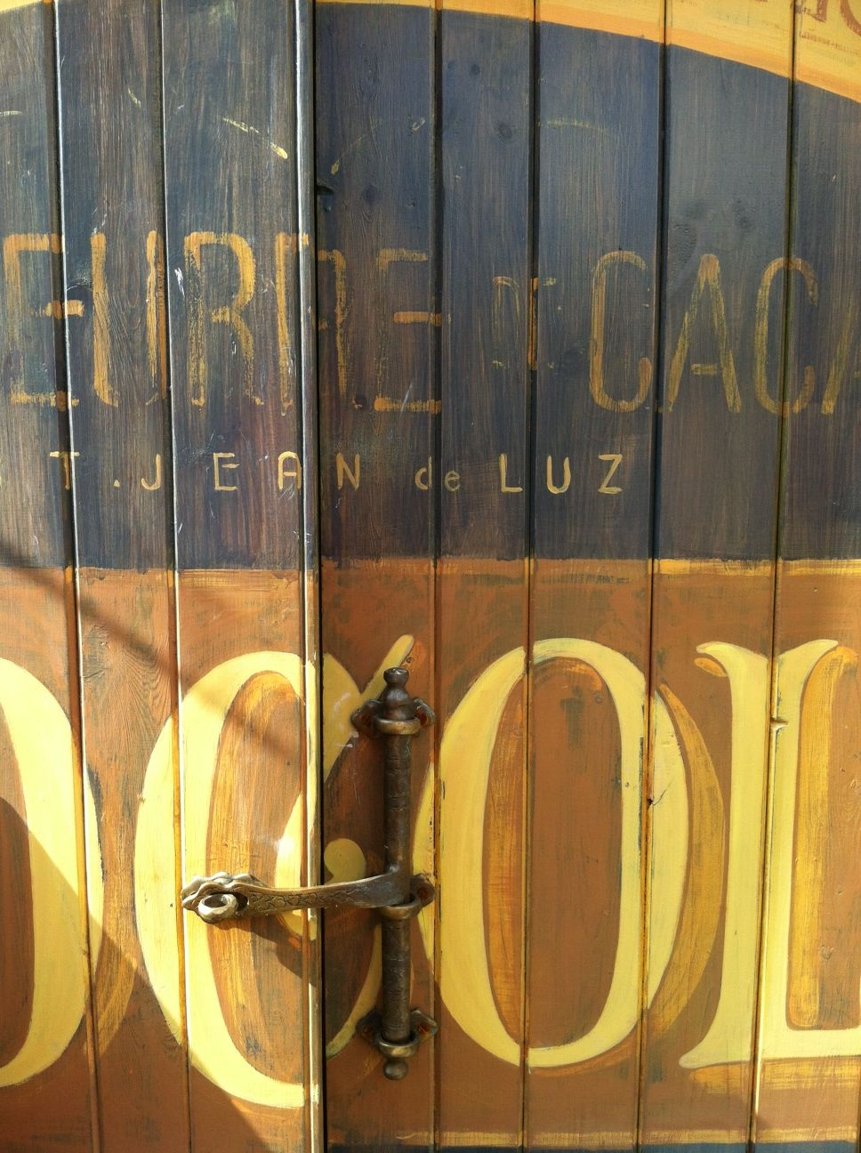 Designed hand painted and written garage doors with an