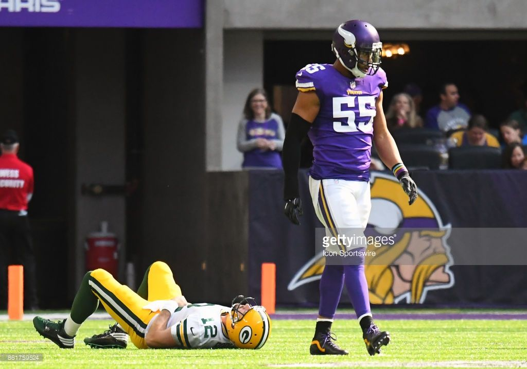 ... linebacker Anthony Barr (55) walks back to the huddle after a big hit  on Green Bay Packers quarterback Aaron Rodgers (12) during a NFL game  between the ... ebc047be2