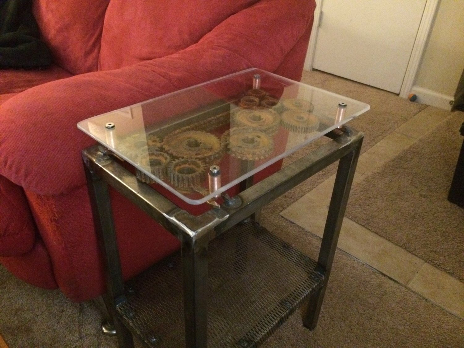 Steampunk end table, handmade TIG welded gears and copper accents.  Industrial design with raw
