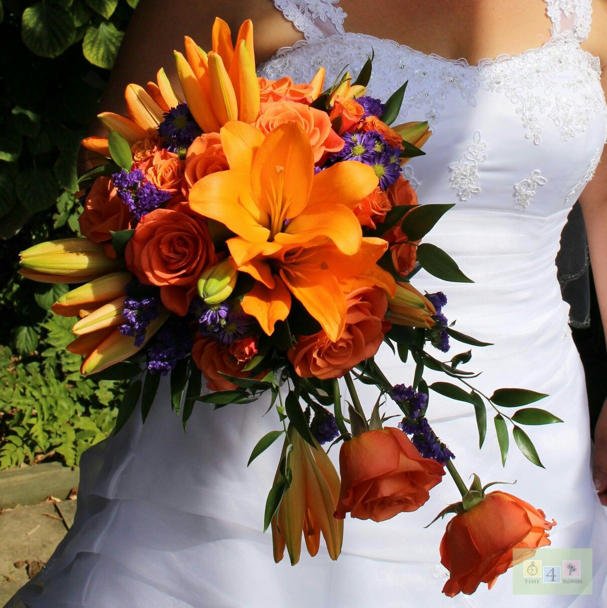 For the daring Bride that isn't afraid to use color. Lovely dramatic cascading bouquet.