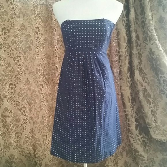 *PRICE DROP!* LILLY PULITZER STRAPLESS DRESS ADORABLE!!!  * White lining with navy blue eyelet fabric on top * Cutout pattern gives a polka dot appearance  * No-slip insert around bust for steady hold * Darted bust * Empire waist * Hidden side zipper  * Gorgeous alone or layer a white/yellow blazer on top * Casual or dressy--you pick! * Excellent condition!  * Feel free to ask for measurements   This item will be cross listed. Reasonable offers always considered. Over 170 items listed so…