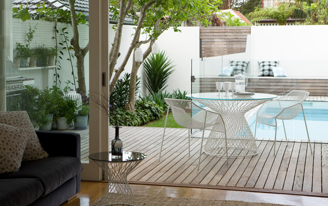 deck and pool in of city garden sydney australia lantern herb pots decking