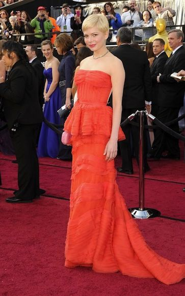 Michelle Williams is stunning. Love the Louis Vuitton Red dress.