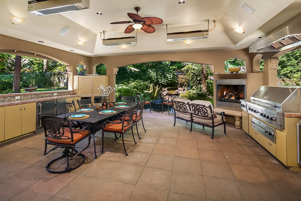 outdoor living space with built in kitchen heaters 2 bars gas fireplace entertainment center on outdoor kitchen and living space id=90178