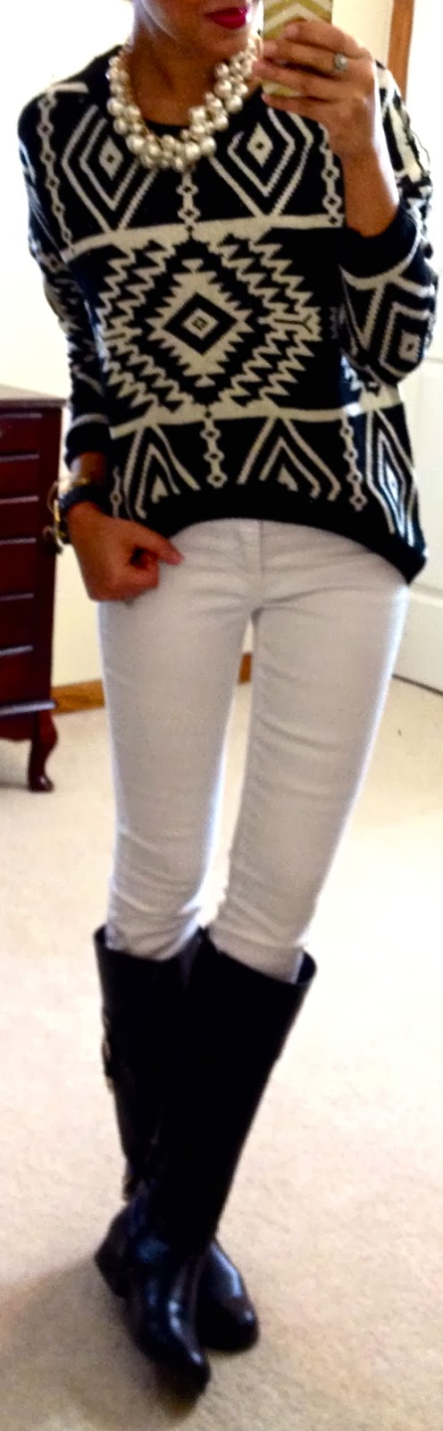 Aztec print sweater, white skinny jeans, boots & pearls.