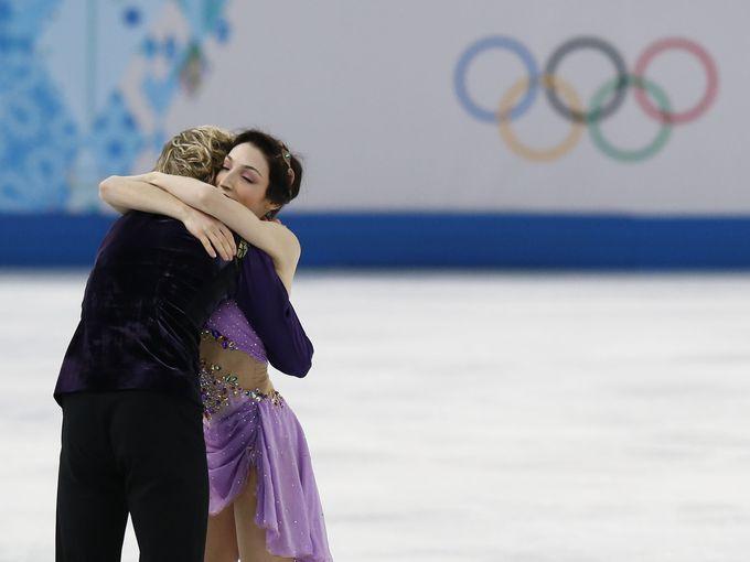 Charlie White and Meryl Davis react following their Olympic Free Dance program.