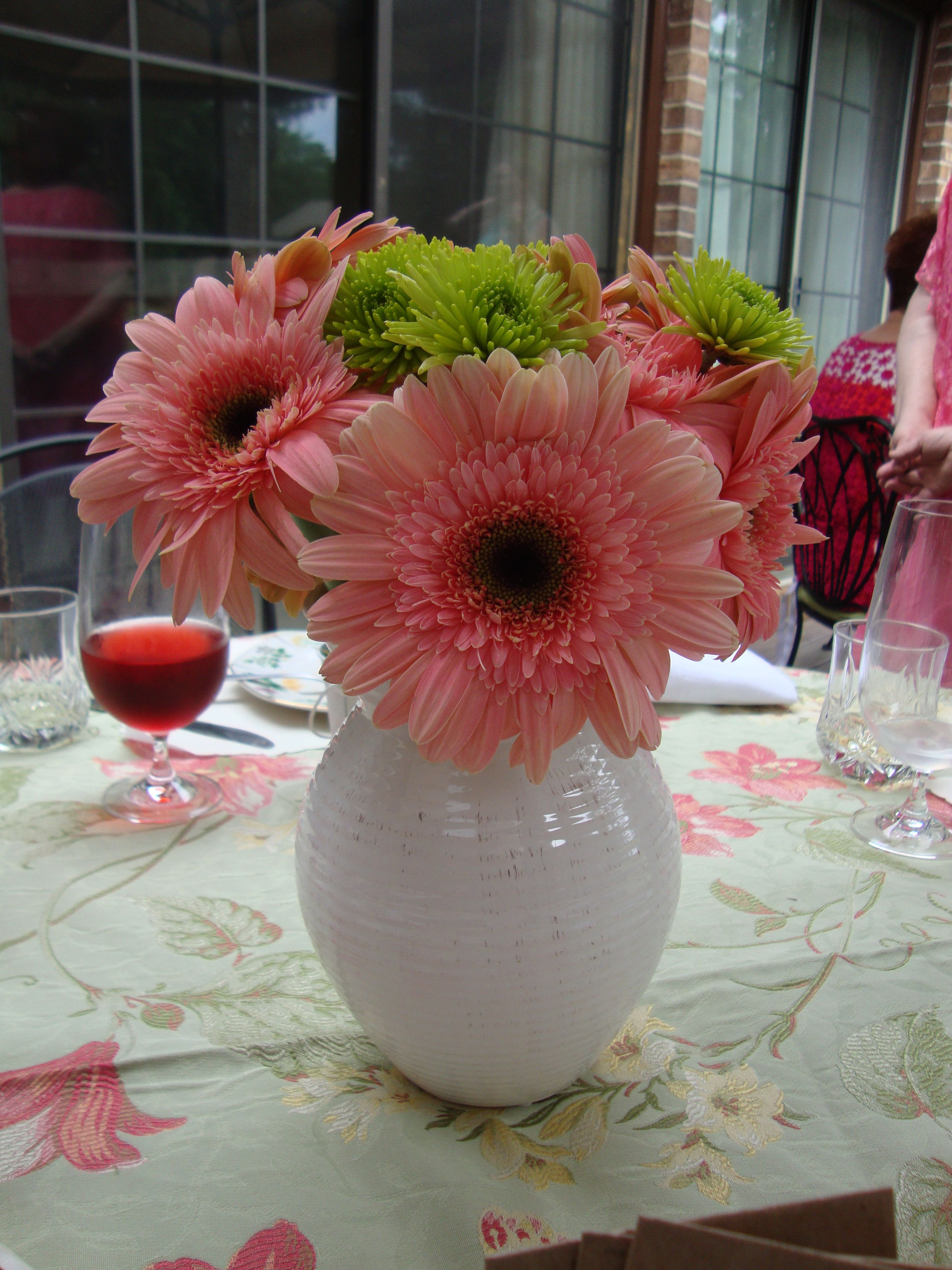 Pink gerber daisies and little green mums in a white ceramic pink gerber daisies and little green mums in a white ceramic pitcher made a great garden reviewsmspy