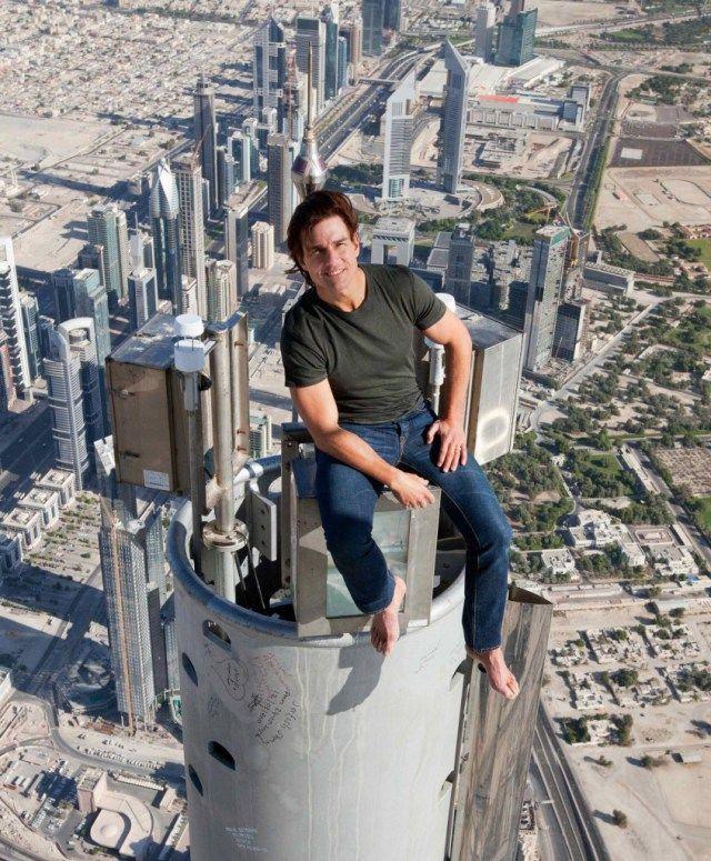 Tom Cruise Sitting On The Very Top Of The Burj Khalifa In Dubai