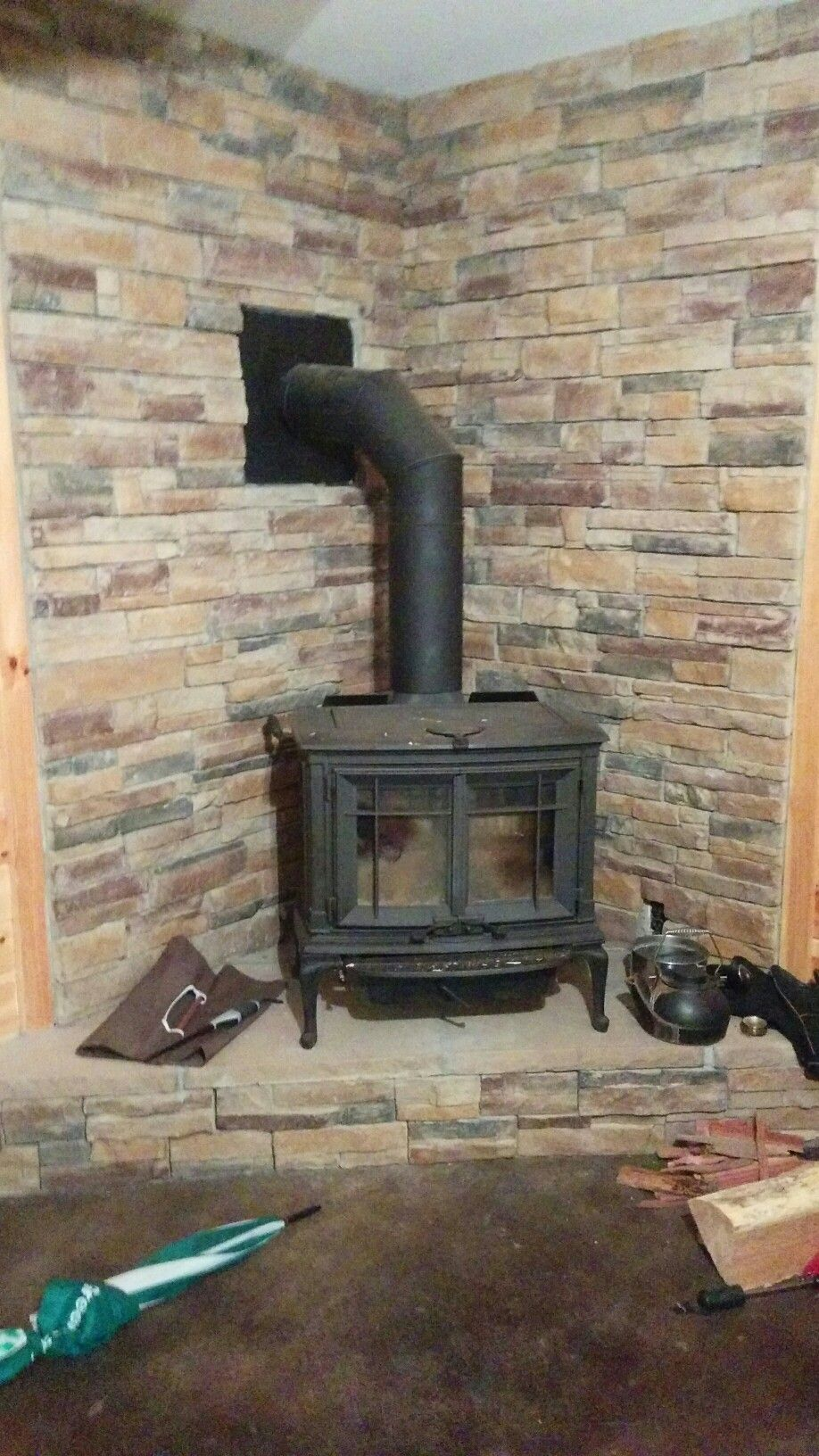 Corner Wood Burning Stove Stone Wall And Raised Platform Wood