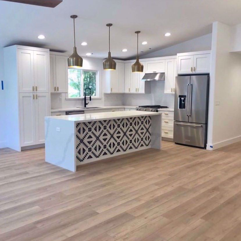 A kitchen remodel isn't complete without COREtec floors. Calypso Oak is featured in this new kitchen designed by @jkaponos - How do you like this look? #kitchen #design #home . . . . . . . . #instadesign #homes #homedecor #decor #stars #homeanddesign #flooring #tile #light #vinyl #style #kidproof #flooring #decor #DIY #stripes