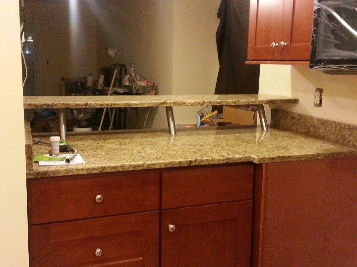 Matt S Brand New Granite Counter Tops And Bar Notice The Bar Top Is On Risers Creating A More Open Aesthetic Feel Granite Countertops Countertops Kitchen