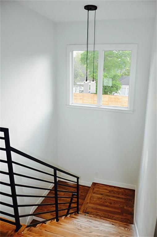 Power House Investors, Inc | Custom Metal Stair Railing And Red Oak  Hardwood Floors Throughout