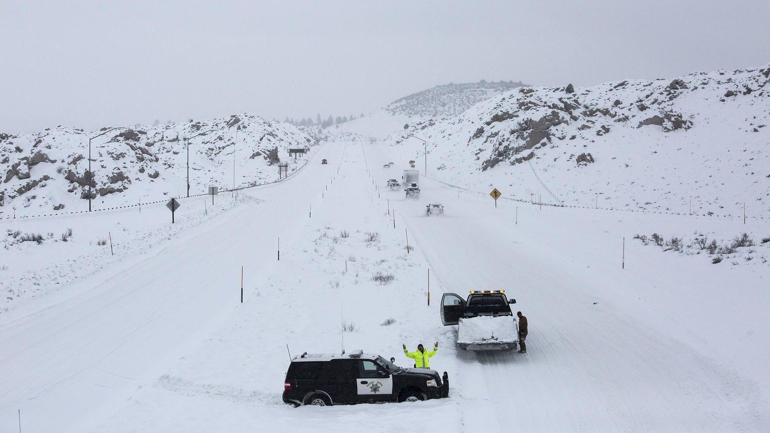 Storm system moves in California highway patrol, Sierra