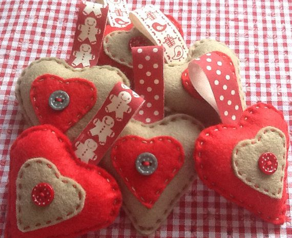 3 x felt Christmas hearts decoration on Etsy, £10.50. Handmade by me PlumpNellie