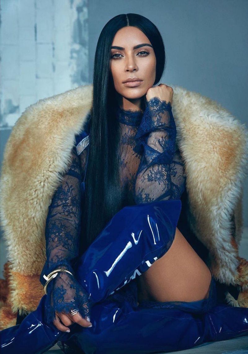 139ff3fd7537 Kim Kardashian lands the October 2017 cover of T Magazine Singapore. The  social media star gets her closeup in a red Givenchy fur coat with a  Cartier ...