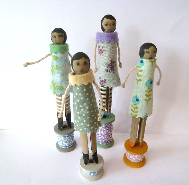 Set of four hand made peg and spool dolls £20.00