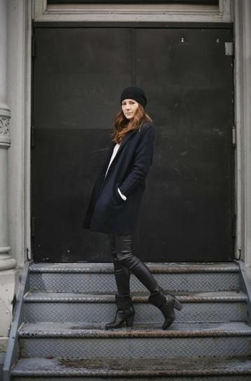Sleek. Black leather pants, ankle boots and a wool coat.