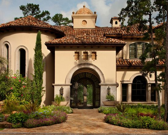 Mediterranean home with iron glass doors architectural for Tuscan roof design