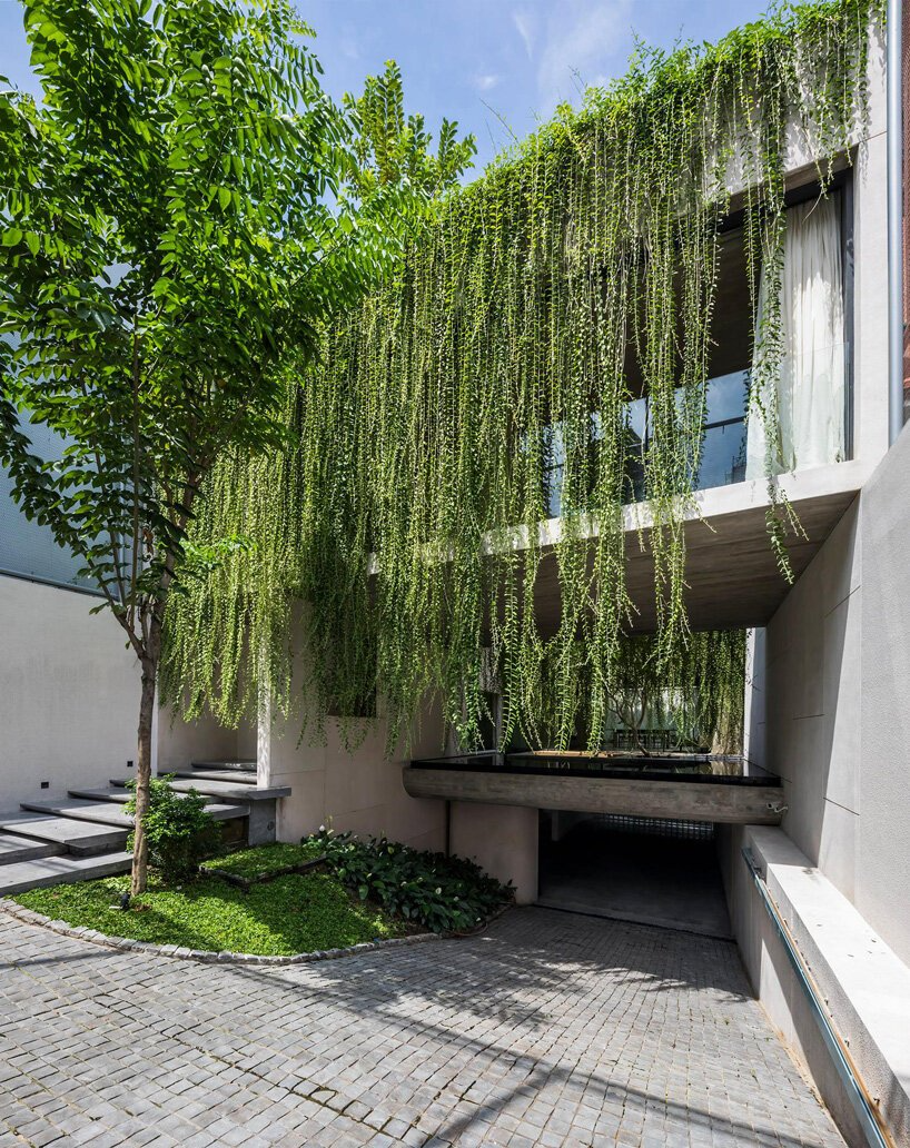 Open Courtyards With Lush Greenery Complete Mia Design Studio S Concrete House In Vietnam Concrete House Hanging Plants House Design
