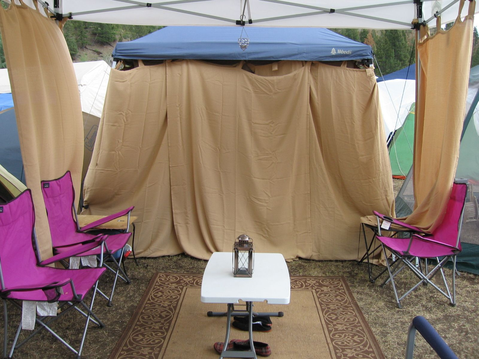 Using Drapes as walls is fairly genius and this is a good *start* for us popup tent users. & Okay so this is ugly - why do I have this up? Because it has ...