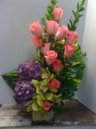 Colorful Medley : Purple hydrangea , green cymbidium orchids and pink roses . $80.00
