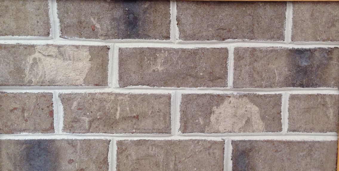 Millstone oversize brick with charcoal mortar (shown with