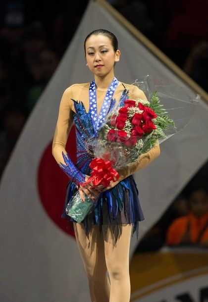 Gold medalist Mao Asada of Japan poses for photos during the medal ceremony at Skate America 2013 in Detroit, Michigan, October 20, 2013.
