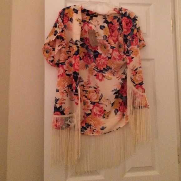 Floral Kimono  NWT floral kimono. So beautiful! It is one size but I would say a small, medium, or large could fit comfortably. It's a little tight for an XL Francesca's Collections Tops