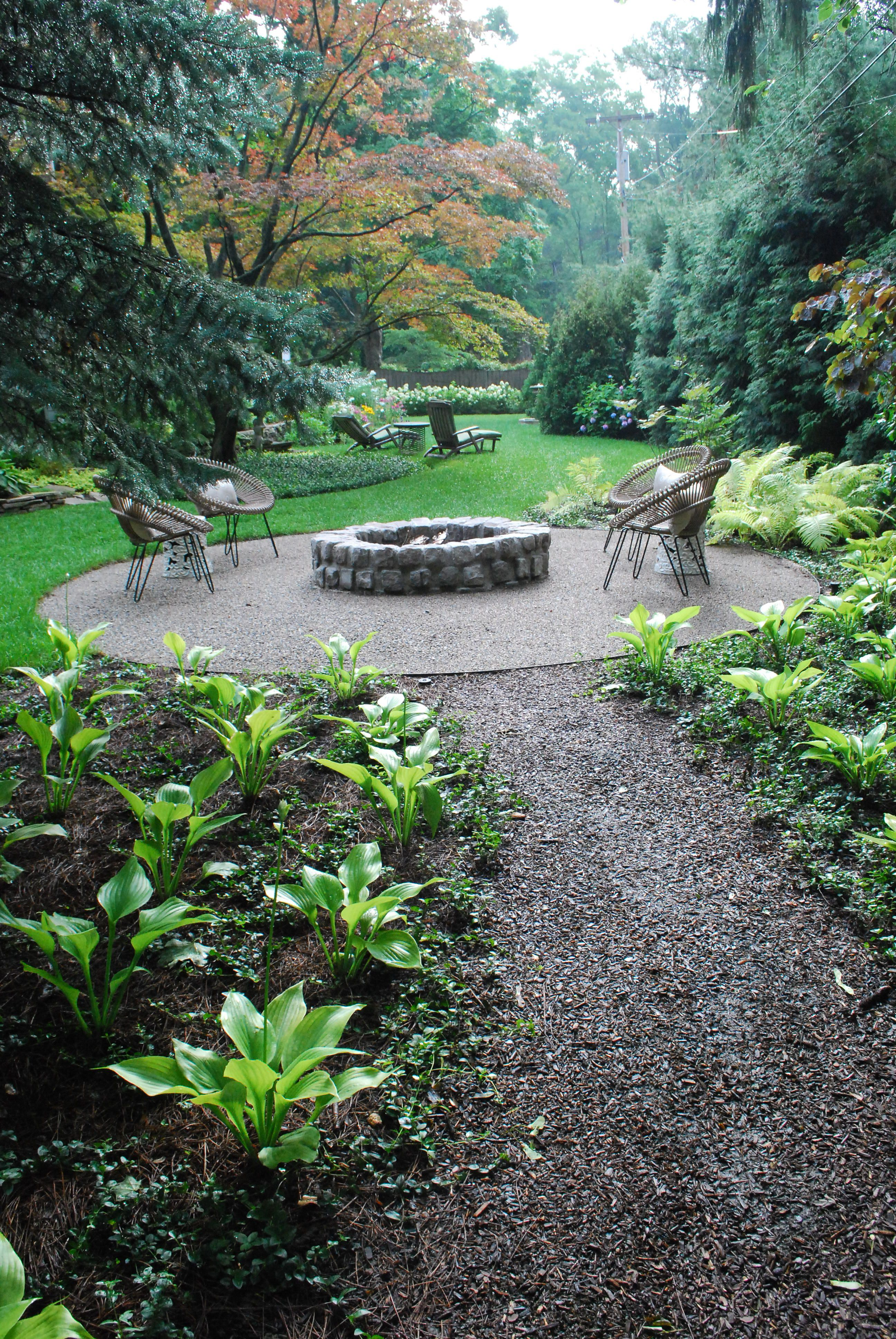 Circular Firepit In The Foreground Is A Strong Visual Stopper It Strongly Serves As A Gesture That Outdoor Fire Pit Shade Garden Design Fire Pit Landscaping