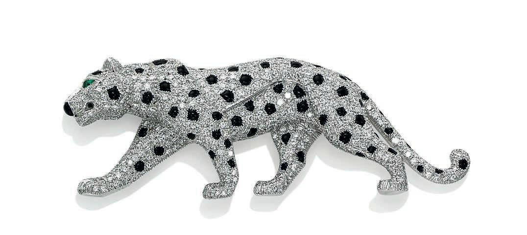 A diamond and onyx Panther brooch, by Cartier