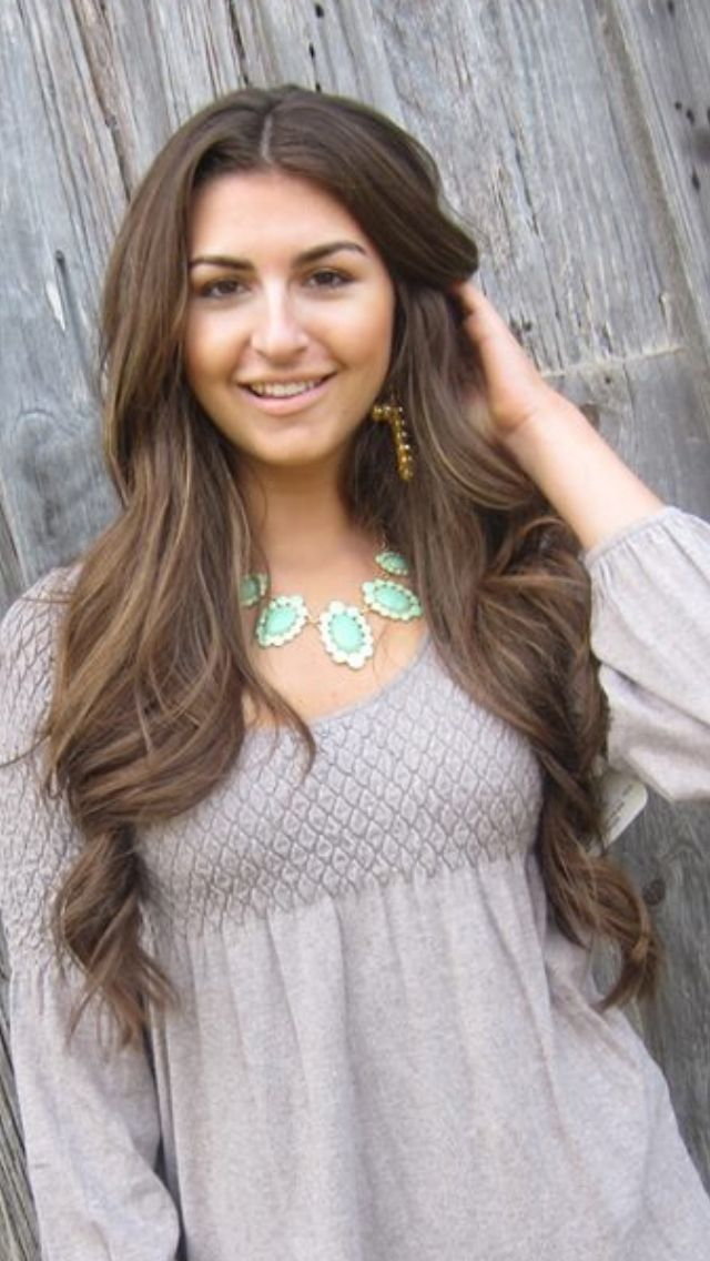 Love her hair color! Brown hair with highlights