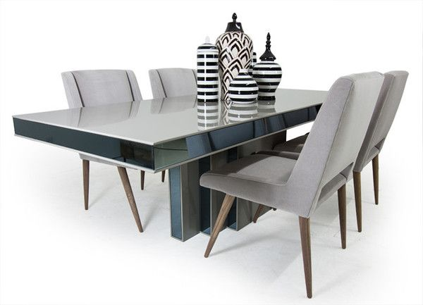 Our Art Deco Dining Table has an amazing architectural quality to it. Its streamlined nature is considerably elevated by its grey high gloss lacquer and smoke mirrored sides. Sleek, clean lines, and r