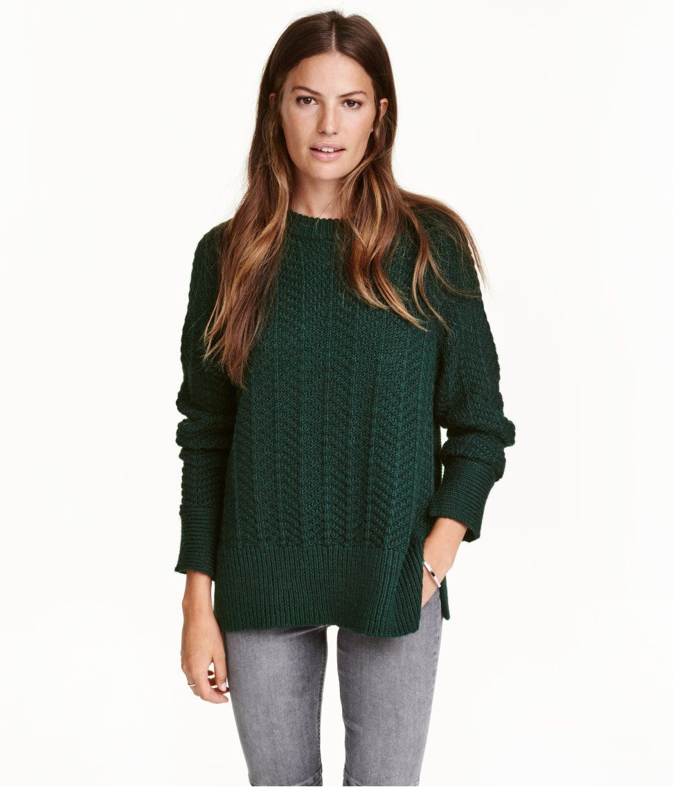 Dark green. Sweater in a soft, textured knit with wool content. Long raglan  sleeves with slits at cuffs and ribbing at cuffs and hem.